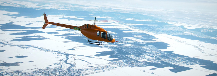 bell 505 jet ranger x flying durring winter